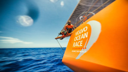 October 26,2014. Leg 1 onboard Team Alvimedica. Day 15. Conditions on the way south along the Brazilian coast are excellent and the miles to Cape Town begin to disappear quickly. Nick Dana cautiously works his way back to the boat after tending to work on the end of the bow sprit. [GoPro image]